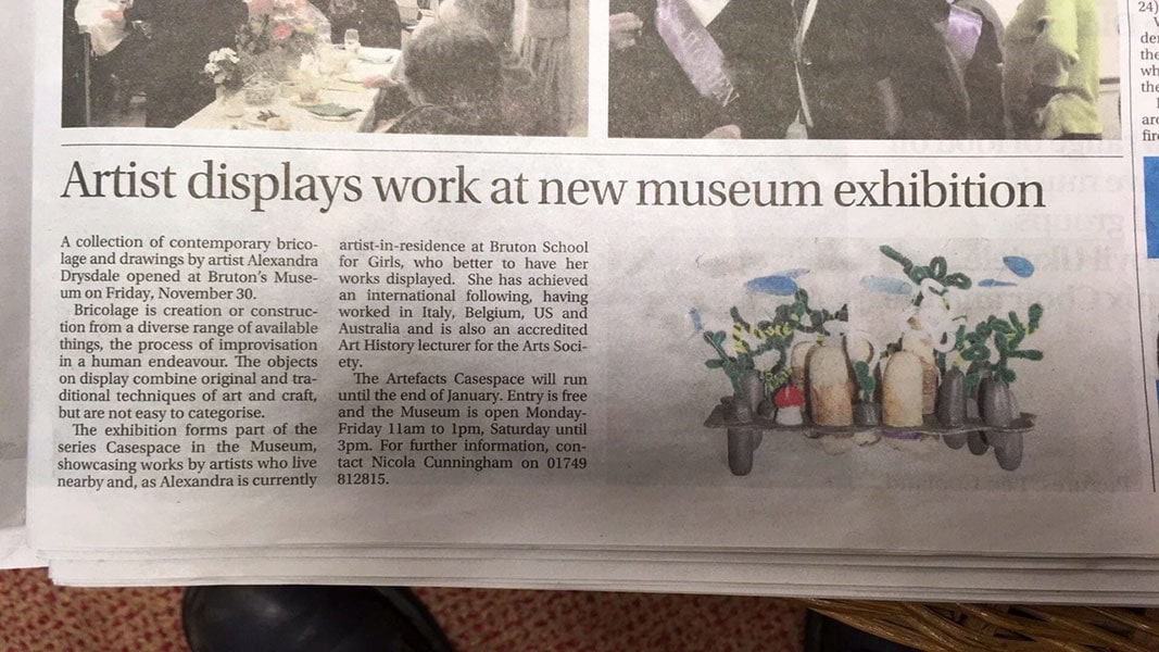 Press coverage of Alexandra Drysdale's exhibition entitled 'The Artefacts of Alexandra Drysdale' featured in the newspaper