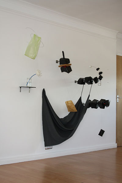 """On the Shelf"" Exhibition 2012 sculptures play with the contrasts of air and earth, substance and emptiness."